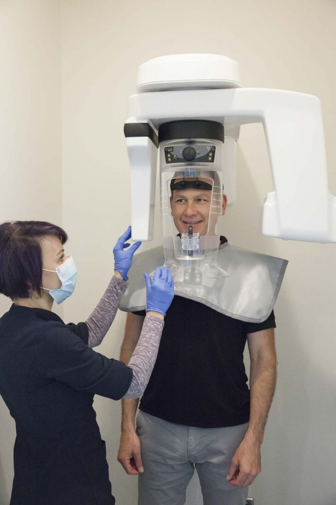 a male patient gets a digital xray of his teeth taken